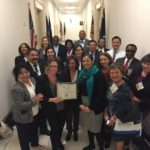 Congresswoman Karen Bass' staff accepts NACHC award presented by representatives of CCALAC, South Central Family Health Center, Eisner Health, Achievable Foundation, St. John's, Venice, Watts, Mission City, UMMA, and HealthRight 360