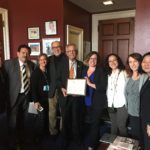 Congressman Alan Lowenthal accepts a NACHC award from representatives of CCALAC, AltaMed, The Children's Clinic, Central City and Harbor Community Clinic.